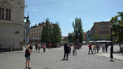 Central Square in Ljubljana, Slovenia, my girlfriend who helps me ride the Settlement Curve.